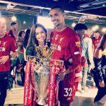 Joel Matip And wife Larissa Stollenwerk lifting the Premier League Trophy