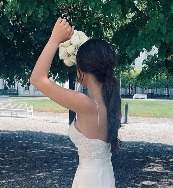 Larissa Stollenwerk in beautiful white and nice ponytail